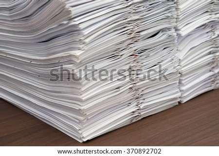 Pile of documents with clips on desk stack up - stock photo