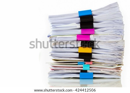 Pile of documents with colorful clips on white background  - stock photo