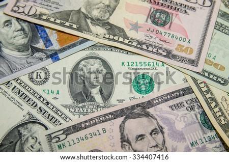 Pile of dollar bills - stock photo