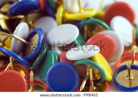pile of drawing pins with coloured tops