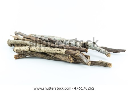 Pile of dry twigs on white background
