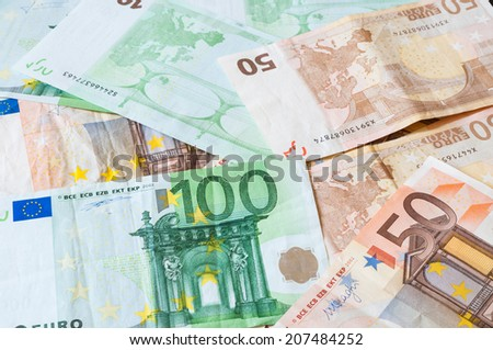 Pile of Euro money for business and finance.  Stock image of money on table to illustrate European economy concept. Different Euro banknotes spread out