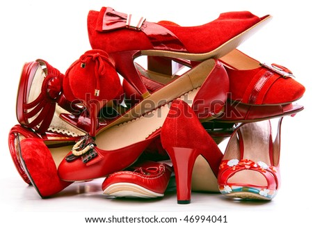 Pile of female red shoes isolated on white background - stock photo