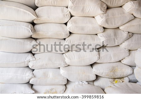 Pile of fertilizer bags, Stacks of fertilizer bags In Warehouse, selective focus - stock photo
