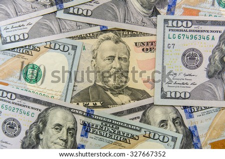 pile of fifty and one hundred dollars bills - stock photo