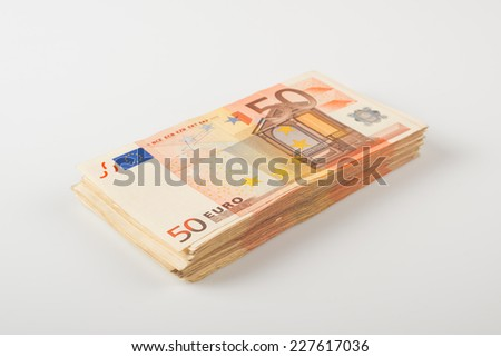 Pile of fifty euro banknotes for financial and economy themes. - stock photo