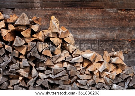 Pile of firewood. Preparation of firewood for the winter. Background - stock photo