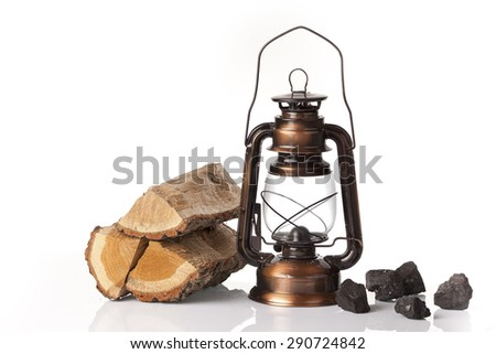 Pile of firewood with coal stones and oil lantern isolated on a white background   - stock photo