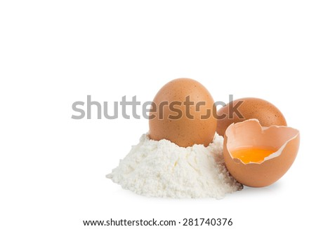 pile of flour and eggs isolated on white with clipping path - stock photo