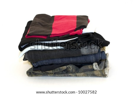 Pile of folded clothes - stock photo