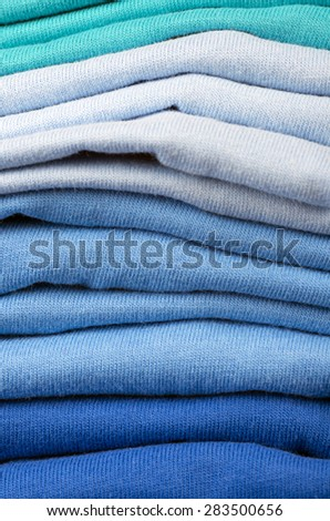 Pile of folded clothes.t-shirts - stock photo