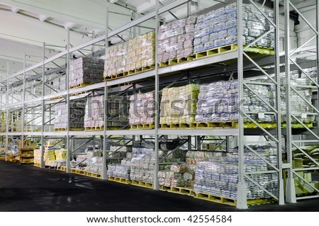 Pile of food production stacked in warehouse shelves