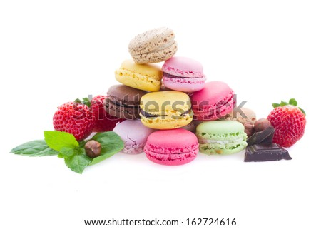 pile of french macaroons with ingredients  isolated on white background - stock photo