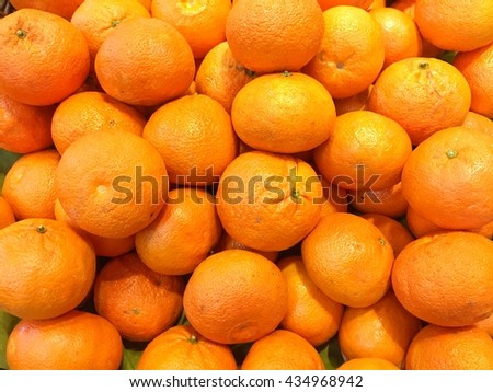 Pile of fresh bright mandarin orange in market ready for sale - stock photo