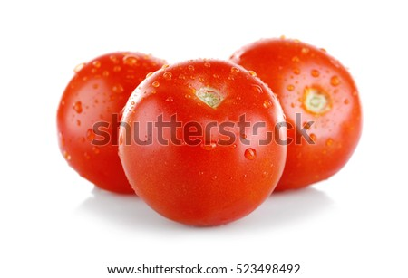 Pile of fresh ripe tomatoes isolated on white