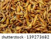 Pile of Fried Anchovies product in Thailand open market. Little fishes contain nutrition like calcium and protein which good for health.  - stock photo