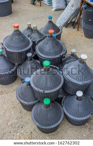 pile of gallons for water and wine at store - stock photo