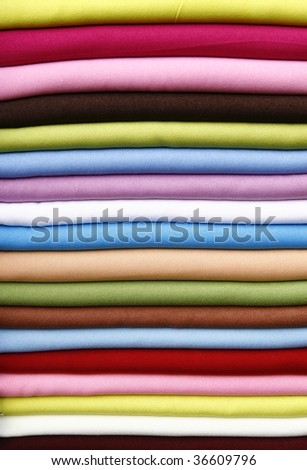 Pile of gentle folded shawls (scarfs) at the market - stock photo