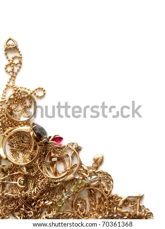 Pile of gold jewelry isolated on white background - stock photo