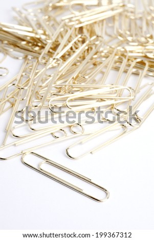 Pile of golden paperclips