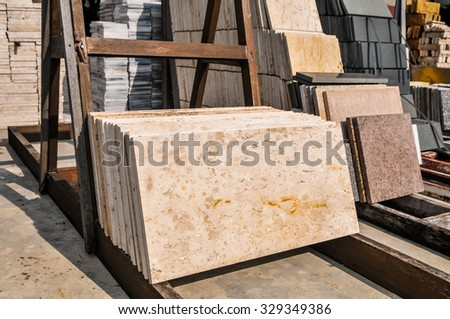 pile of granite texture -  marble layers design gray stone slab surface grain rock backdrop layout row industry construction - stock photo