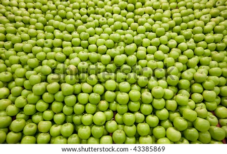 Pile of green apples forming a background - stock photo