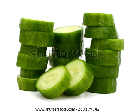 pile of green cucumber slices on white background