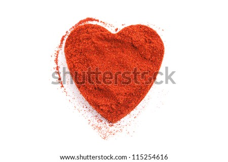 Pile of ground Paprika isolated in heart shape on white background. Used to color rices, stews, and soups, meats. - stock photo