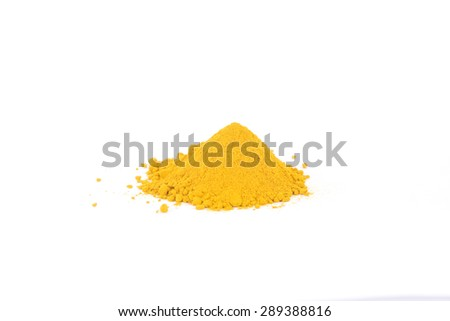 Pile of ground turmeric in the centre of a white background