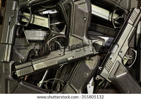 Pile of handguns - stock photo