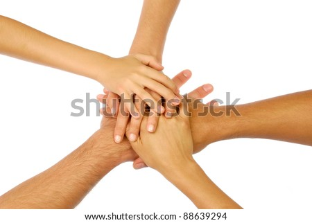 Pile of hands isolated on white symbolizing unity - stock photo