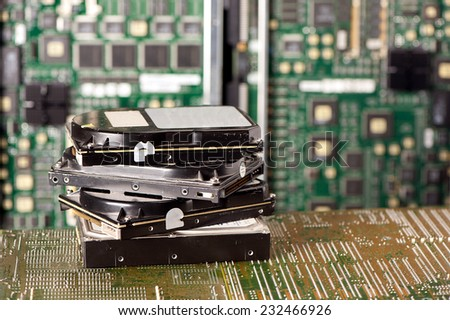 pile of hard drives and motherboard - stock photo