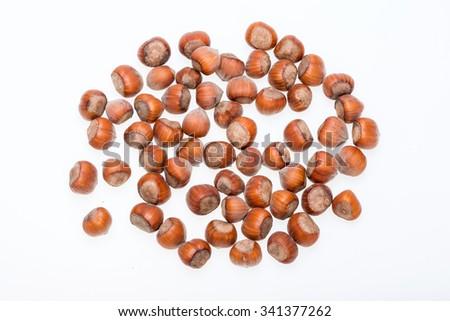 Pile of hazelnuts isolated on white background  - stock photo