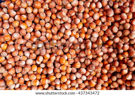 Pile of healthy hazel nuts. Good for a nutty background. Health food concept. - stock photo