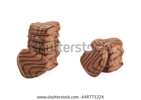 Pile of heart shaped cookies covered with the chocolate glaze, isolated over the white background, set of two different foreshortenings