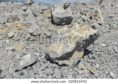 pile of limestone in quarry - stock photo