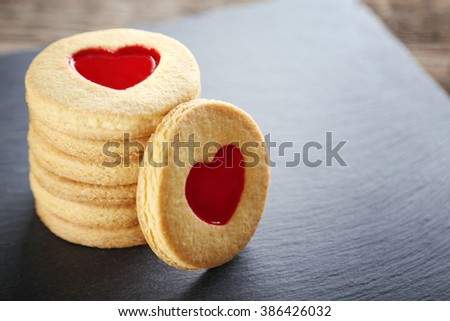 Pile of love cookies on grey stand, closeup - stock photo