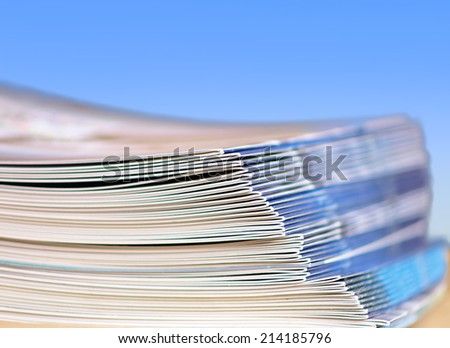 Pile of magazines on a table - stock photo