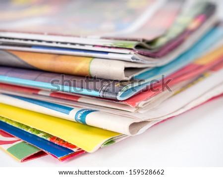 Pile of magazines on white - stock photo