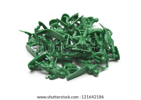 pile of many toy soldiers on white background - stock photo