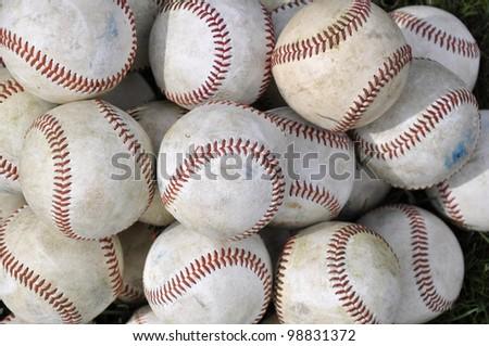 pile of many used baseballs - stock photo