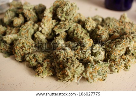 Pile of medical marijuana on a table.