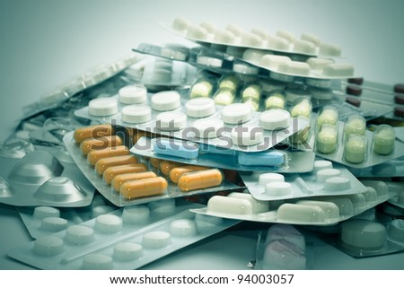 Pile of medical supplies, pills, capsules and tablets. - stock photo