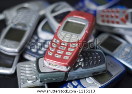 Pile of mobile cell phones - stock photo