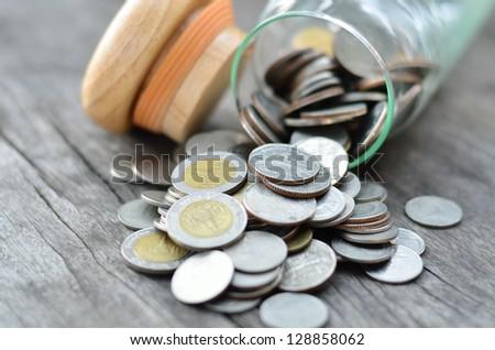 pile of money on wood background - stock photo