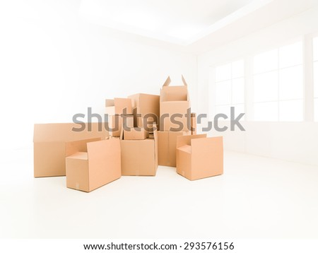 pile of moving boxes in empty house. copy space available - stock photo