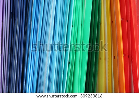 pile of multi-colored folders for office papers - stock photo