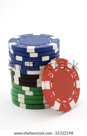Pile of multicolor poker chips isolated on white.