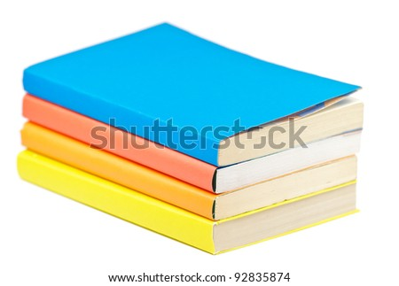 Pile of multicolored books on white background - stock photo