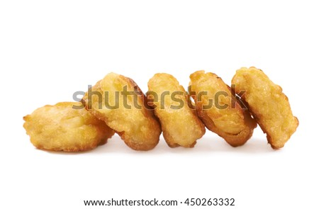Pile of multiple breaded chicken nuggets isolated over the white background - stock photo